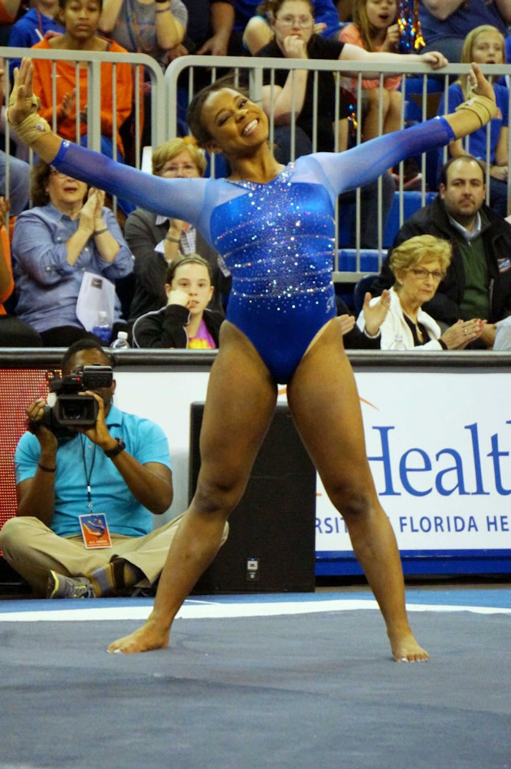 <p>Kennedy Baker performs her floor exercise during Florida's 197.60-196.950 win against Georgia on Friday in the O'Connell Center.</p>