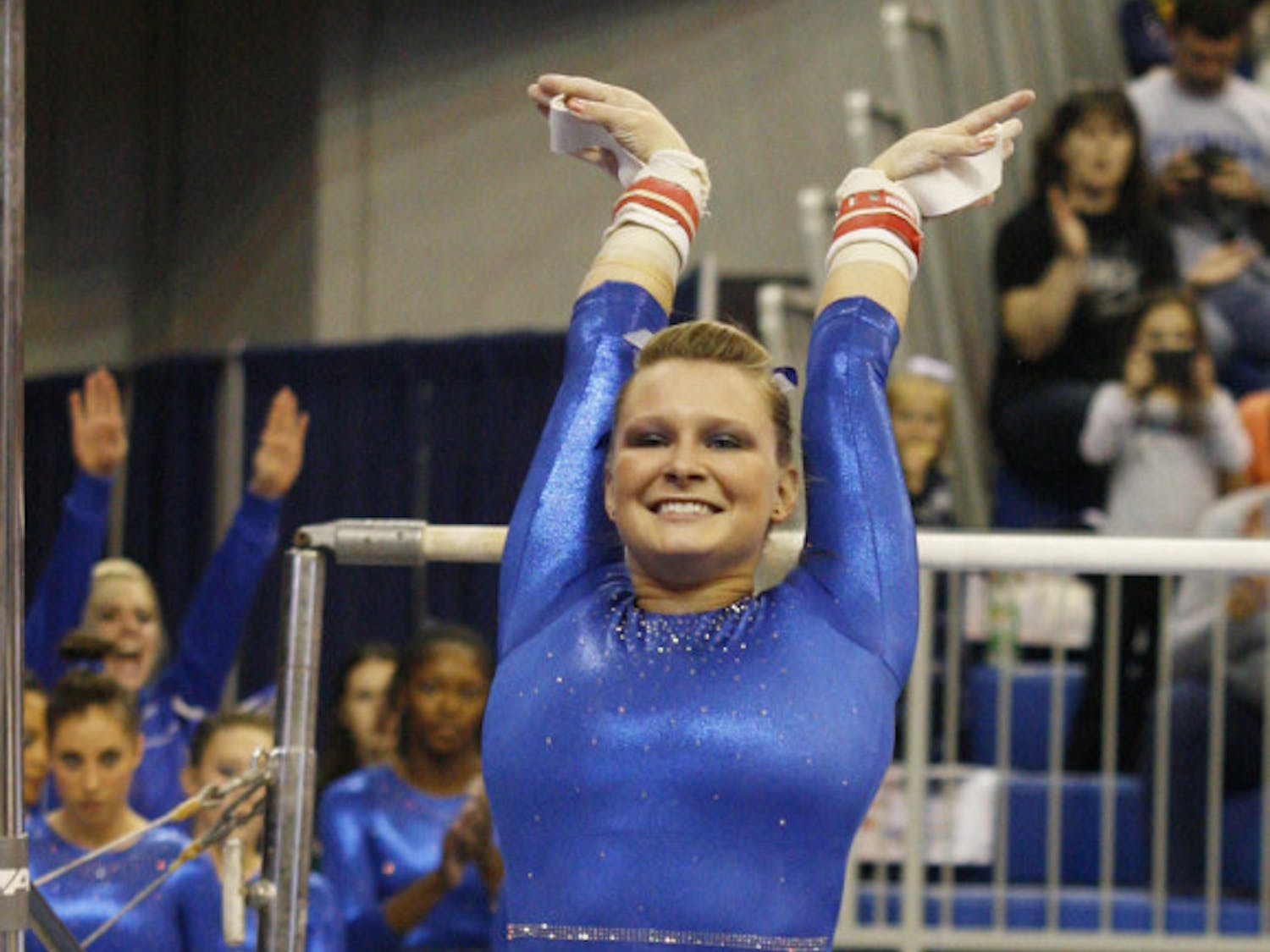 Bridget Sloan sticks a landing during Florida's 196.575-190.55 win against Ball State on Jan. 4, 2013, in the O'Connell Center. Sloan won two events when Florida faced Georgia in the NCAA Super Six.
