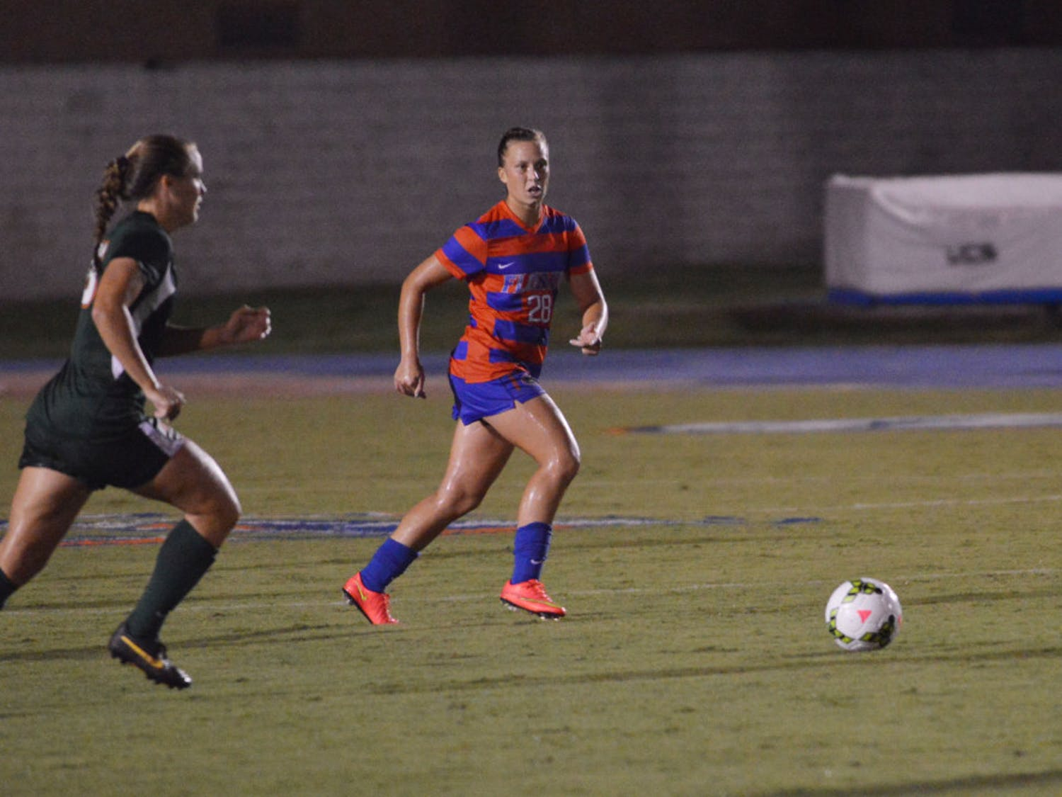 Sophomore midfielder Meggie Dougherty Howard runs toward the ball during Florida's 3-0 win against Miami on August 22, 2014, at James G. Pressly Stadium.
