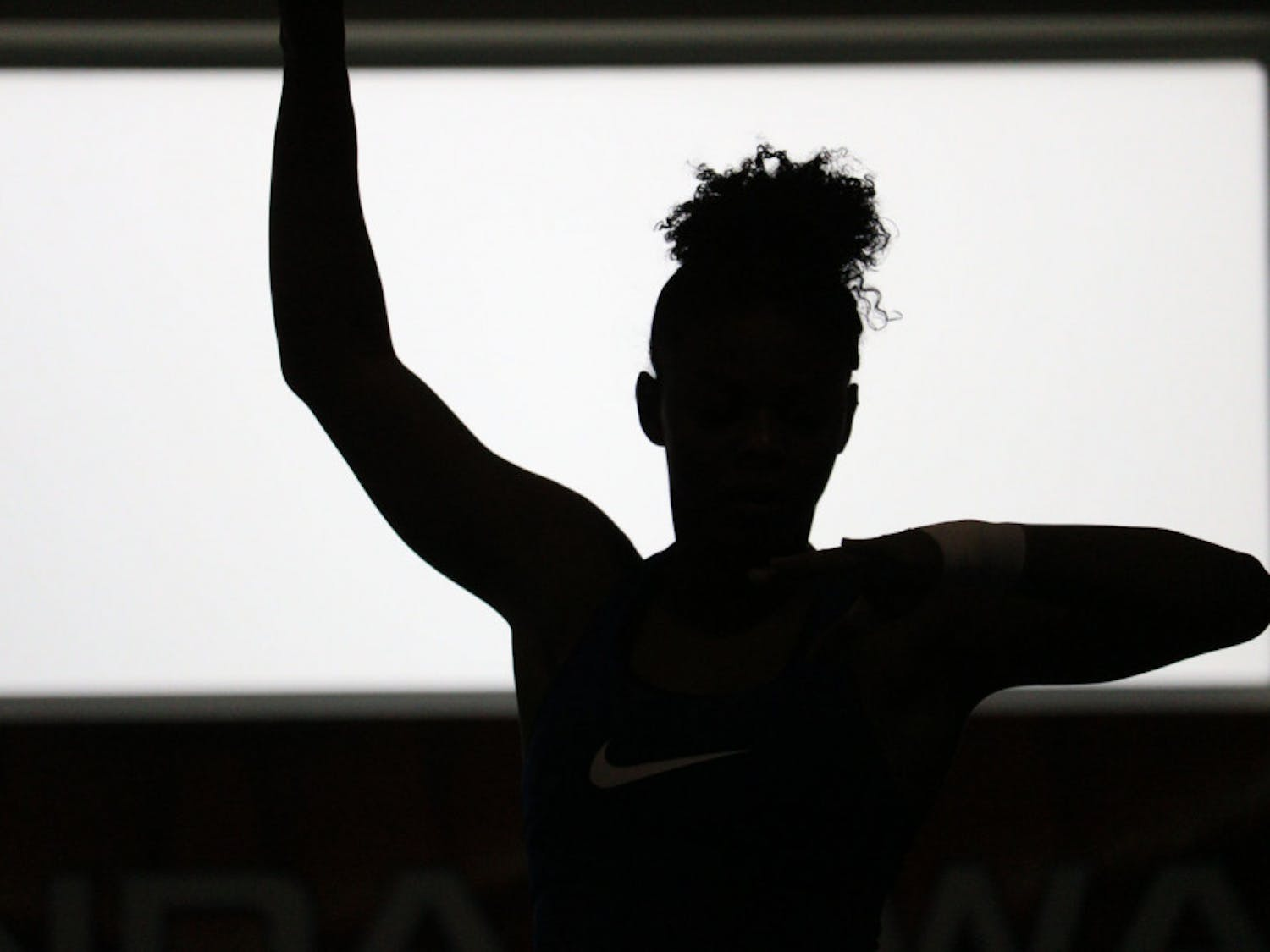 Trinity Thomas, an 18-year-old applied physiology and kinesiology sophomore and UF gymnast, practices her routine on the balance beam. The balance beam routine is a mix of dance and gymnastic routine.