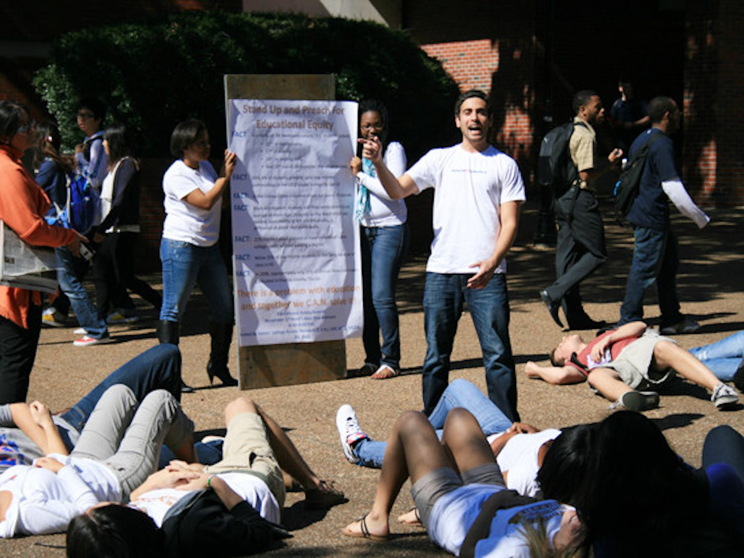 About 15 students drop down onto the pavement in the middle of Turlington Plaza on Tuesday afternoon, representing the students who drop out of high school every 26 seconds in the U.S. Read the story at alligator.org.