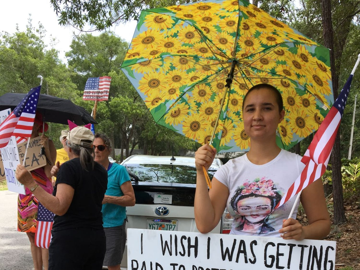 Marcela Mulholland, a 19-year-old UF political science and sustainability studies junior, stands outside U.S. Rep. Ted Yoho's office on Tuesday afternoon. Mulholland said she believes millennials speaking out will have a huge impact on the future.