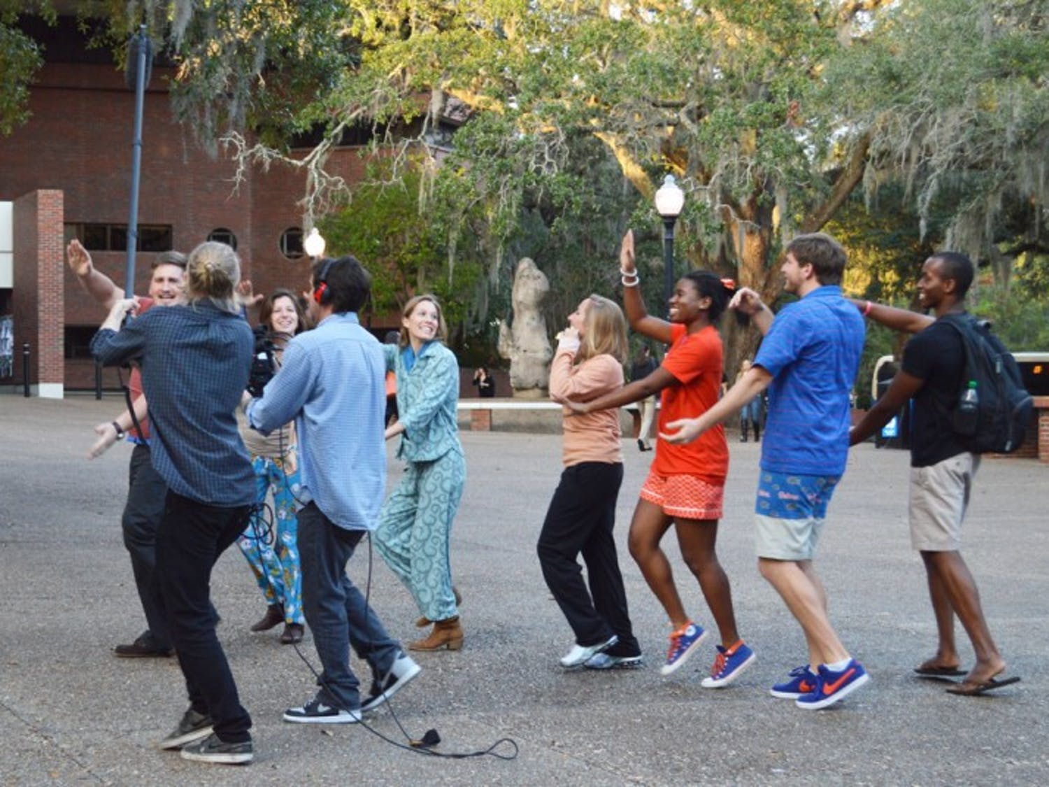 Students reenact the old UF tradition of the impromptu pajama parade, which freshmen would participate in, for a Reese's video. Reese's is visiting campuses across the country to make videos about college traditions.