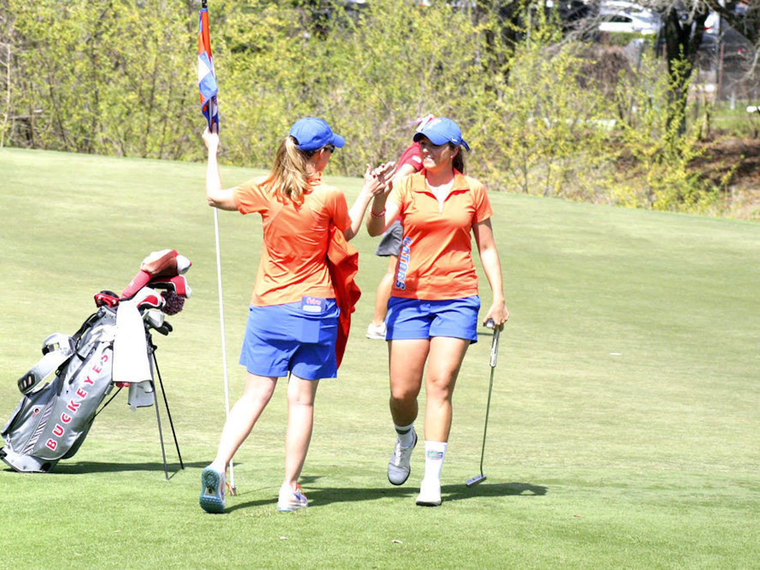 Karolina Vlckova (right) celebrates with coach Emily Glaser during the 2015 Suntrust Gator Invitational at the Mark Bostick Golf Course in Gainesville.