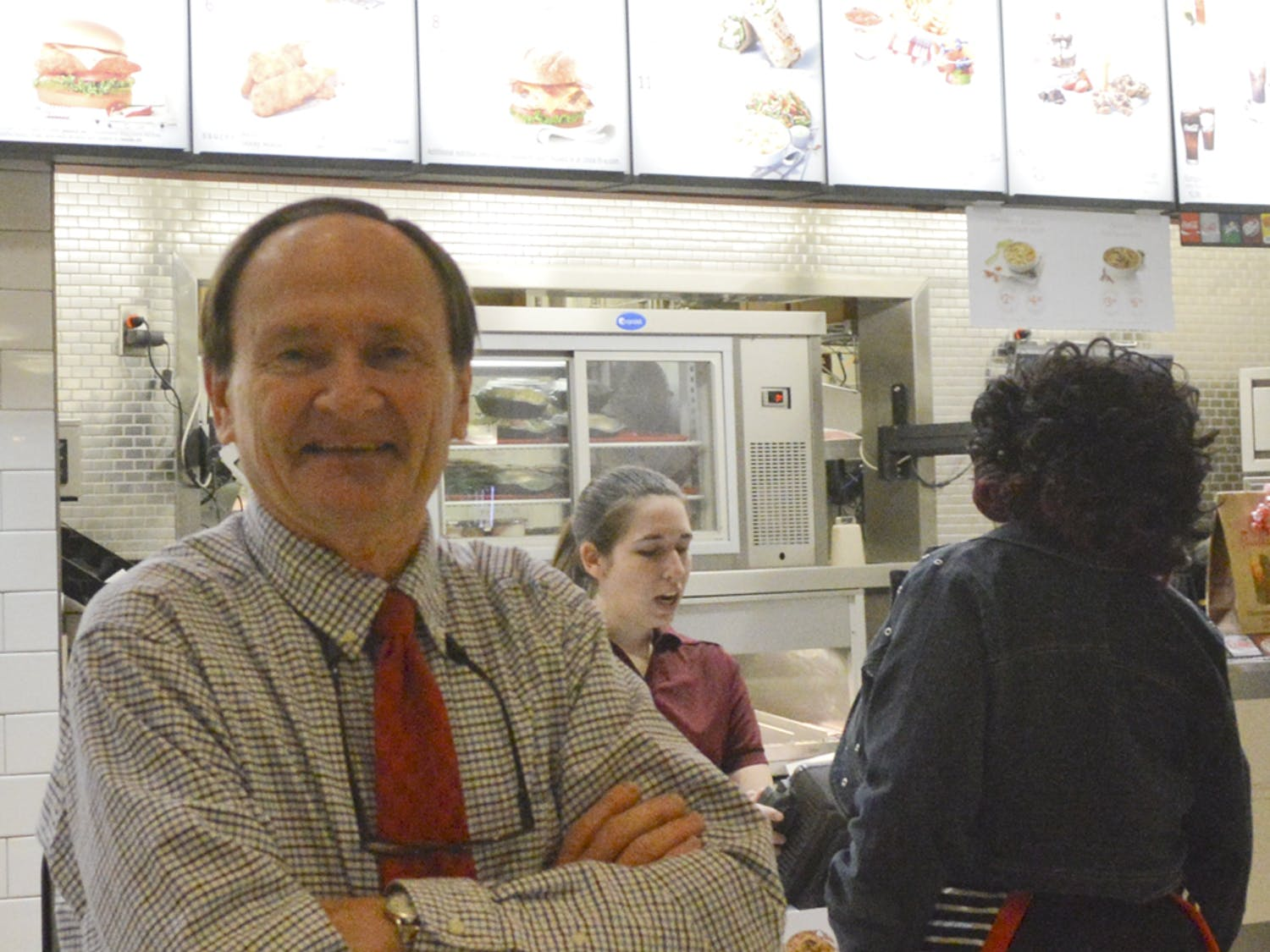 Steve Carroll, owner of the Oaks Mall's last locally owned store, stands in Chick-fil-a and poses for a picture. Carroll's restaurant opened in 1978 and was one of the mall's original stores.