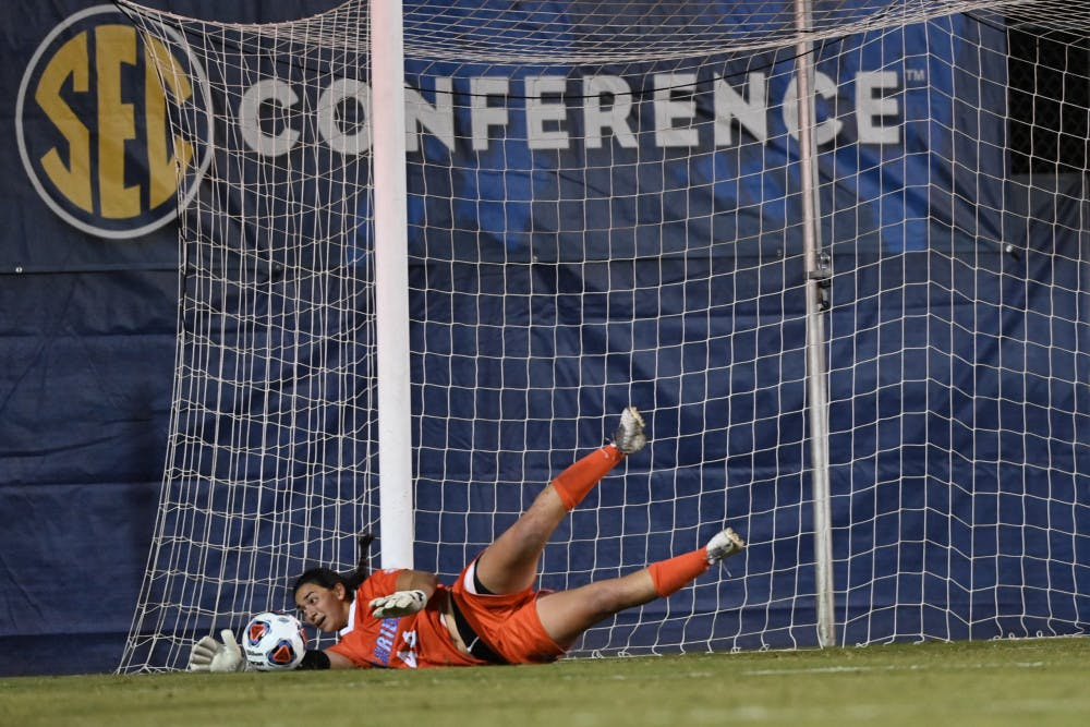 <p>Goalkeeper Susi Espinoza dives for a save in the opening game of the SEC Tournament on Friday. After winning 6-5 in overtime on Nov. 13, the Gators tournament hopes were dashed Sunday night when they lost to Missouri.</p>