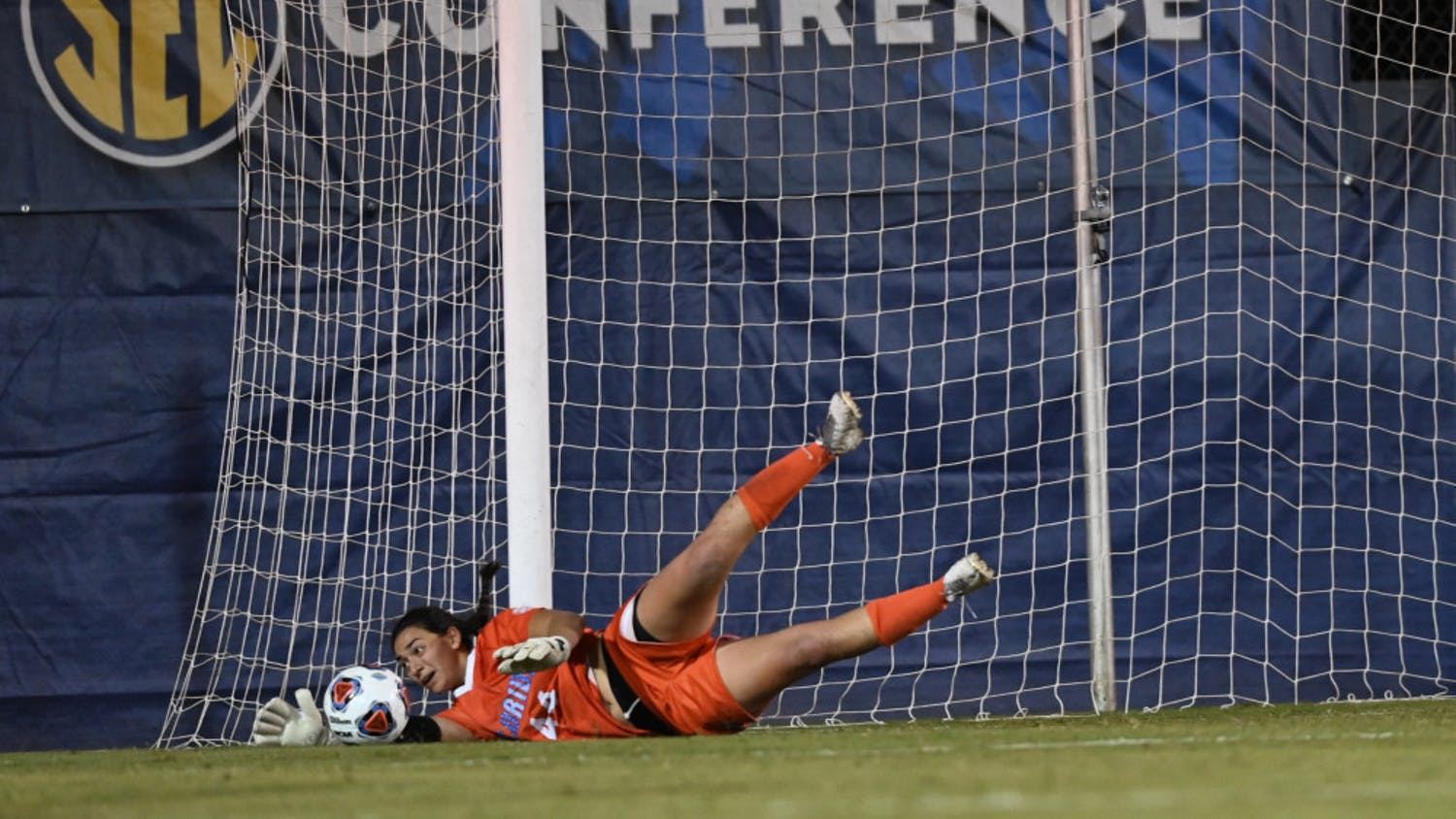 Goalkeeper Susi Espinoza dives for a save in the opening game of the SEC Tournament on Friday. After winning 6-5 in overtime on Nov. 13, the Gators tournament hopes were dashed Sunday night when they lost to Missouri.