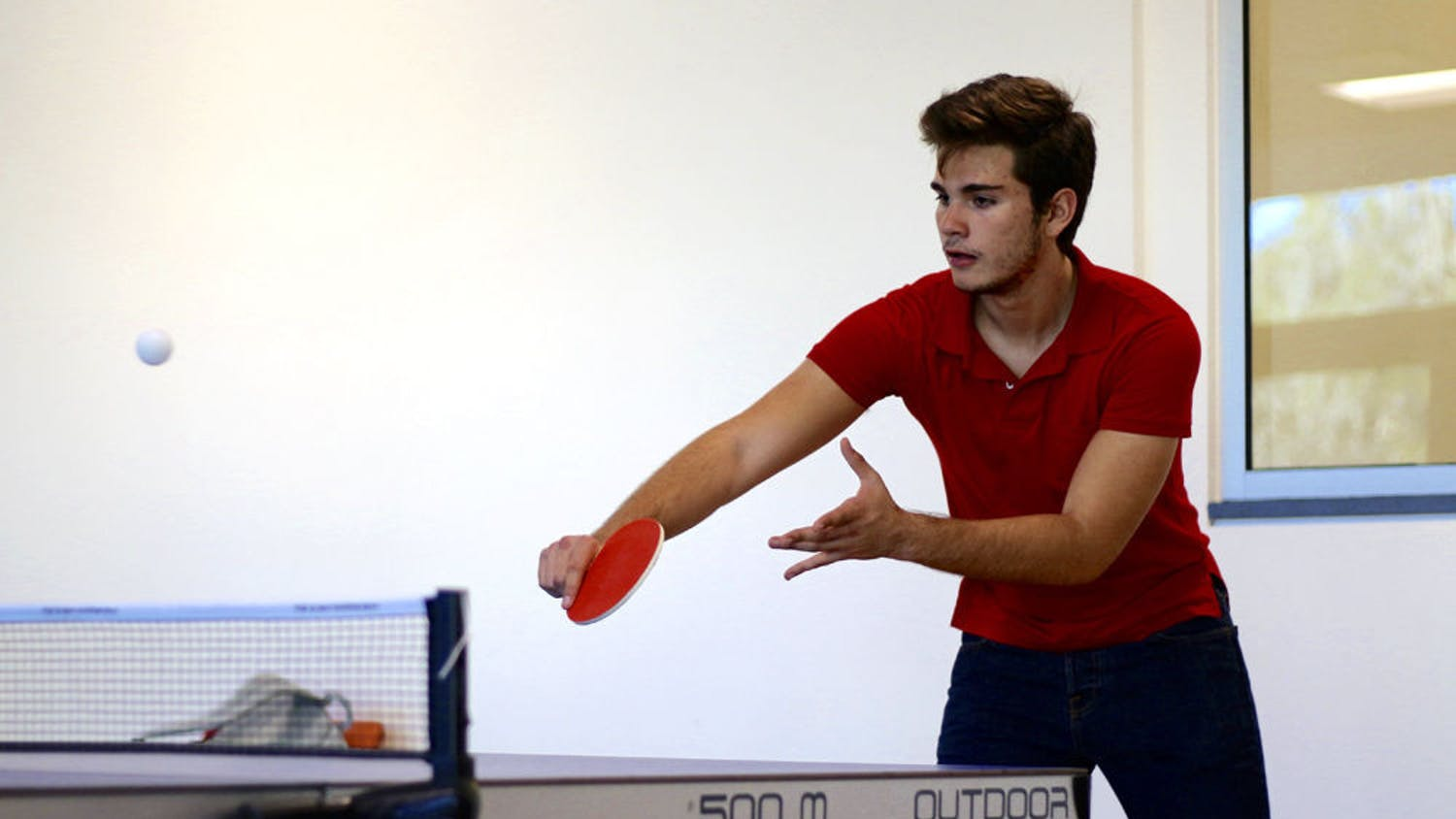 Esteban Siles, an 18-year-old industrial engineering freshman, plays a game of table tennis with his friend Carlos Ancaten in the recently opened Reitz Union Game Room on Tuesday afternoon.