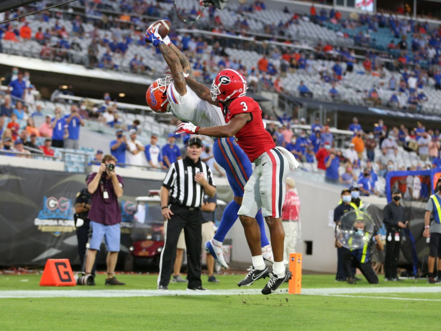 Wide receiver Trevon Grimes stretches to catch the football ball thrown by Gators quarterback Kyle Trask and score a touchdown for Florida against Georgia at TIAA Bank Field on Nov. 7, 2020.