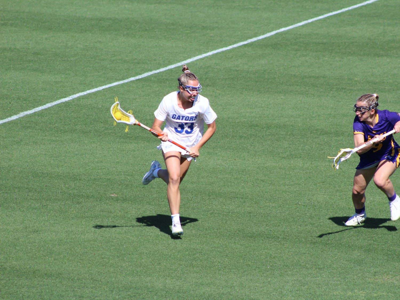 Defender Kaitlyn Dabkowski attacks the East Carolina net on April 1.