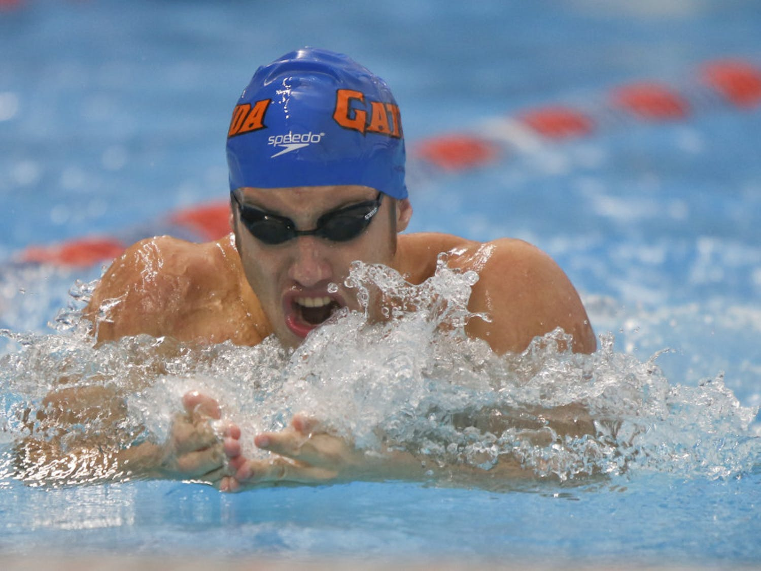 Junior Matt Elliott competes in the men's open 100 breast at the Pinch a Penny All-Florida Invitation at the Stephen C. O'Connell Center on Sept. 28.