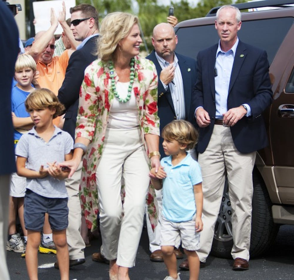 <p>Ann Romney walks with two of her grandchildren after greeting supporters at David's Real Pit BBQ located on Northeast 23rd Avenue on Thursday afternoon.</p>