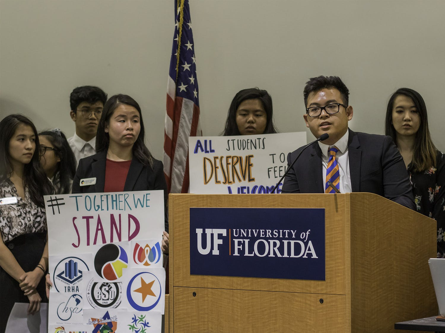 """Kevin Nguyen, president of the Vietnamese Student Organization, speaks during the public comment part of the UF Student Government Senate meeting on Aug. 6. Nguyen began by stating things SG members all have in common. He said that they were all Gators, all served in the Senate and all could make a difference. """"We all have the potential to do something great,"""" Nguyen said."""