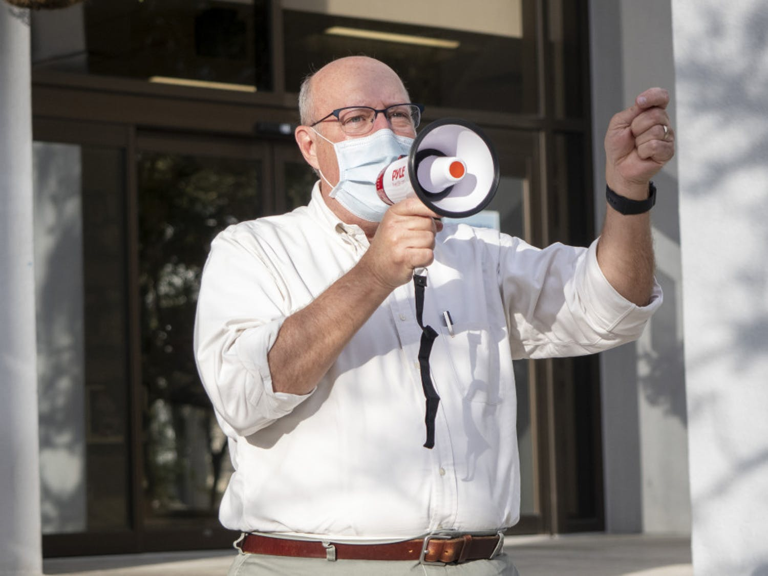 """Gainesville Commissioner for district 2, Harvey Ward, is seen giving a short speech during the """"Protect the Results"""" rally held at the Alachua City Hall on Wednesday, Nov. 4, 2020. (Emily Felts/Alligator Staff)"""