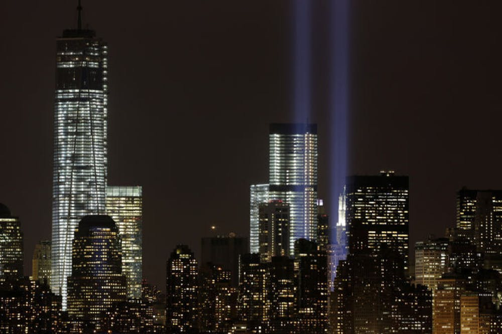 <p>The Tribute in Light rises above the lower Manhattan skyline and Four World Trade Center, center, and One World Trade Center, left, in a test of the memorial light display, Monday, Sept. 9, 2013 in New York. The twin beams of light will also appear Wednesday, Sept. 11, twelve years after the terrorist attacks of Sept. 11, 2001. (AP Photo/Mark Lennihan)</p>