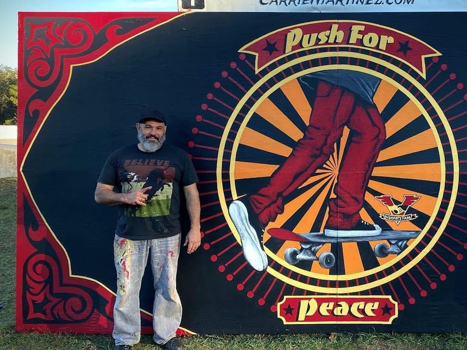 "Carrie and Jesus Martinez painted a ""Push for Peace"" mural at Possum Creek Skatepark. Jesus Martinez said his clothes always end up caked in paint and sometimes become too stiff to wear again."