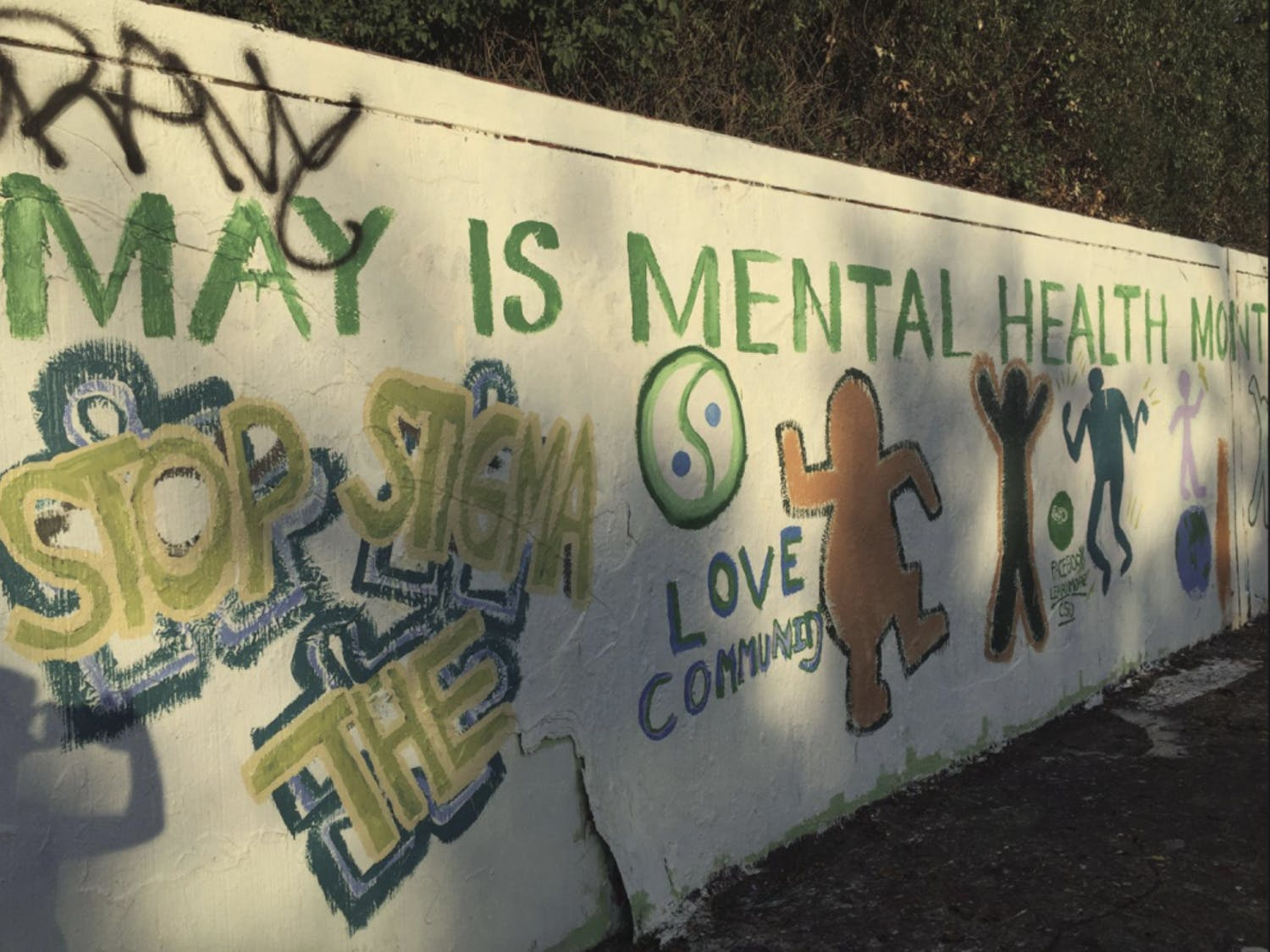 """A mural painted on the 34th Street Wall in May 2017 in honor of Mental Health Awareness Month by local group AnARTists signifies the organization's belief that """"Art Heals."""" One of the organization's goals is to stop the stigma behind mental illness."""