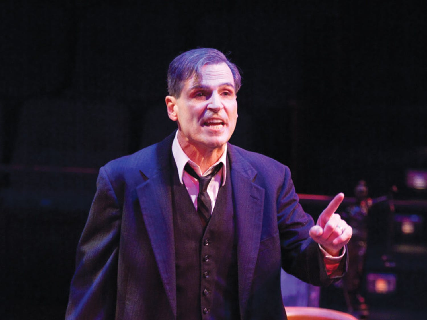 Paul Morella, playing Clarence Darrow, looks at a temporary jury of audience members at the Hippodrome State Theatre on Monday night.