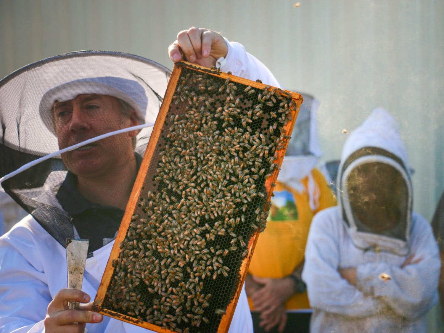 After explaining to Bee College 2018 attendees how to split beehives, Rob Horsburgh, 43, demonstrates the steps Friday, Oct. 14, 2018. The event was hosted by the UF IFAS Honey Bee Research and Extension Lab and offered a variety of classes on beekeeping.