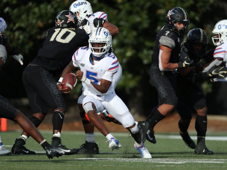 Gators backup quarterback Emory Jones zig zags between Vanderbilt defenders in Nashville, Tennessee, on Nov. 21. Jones threw Florida's final touchdown pass in their 38-17 win over the Commodores Saturday.