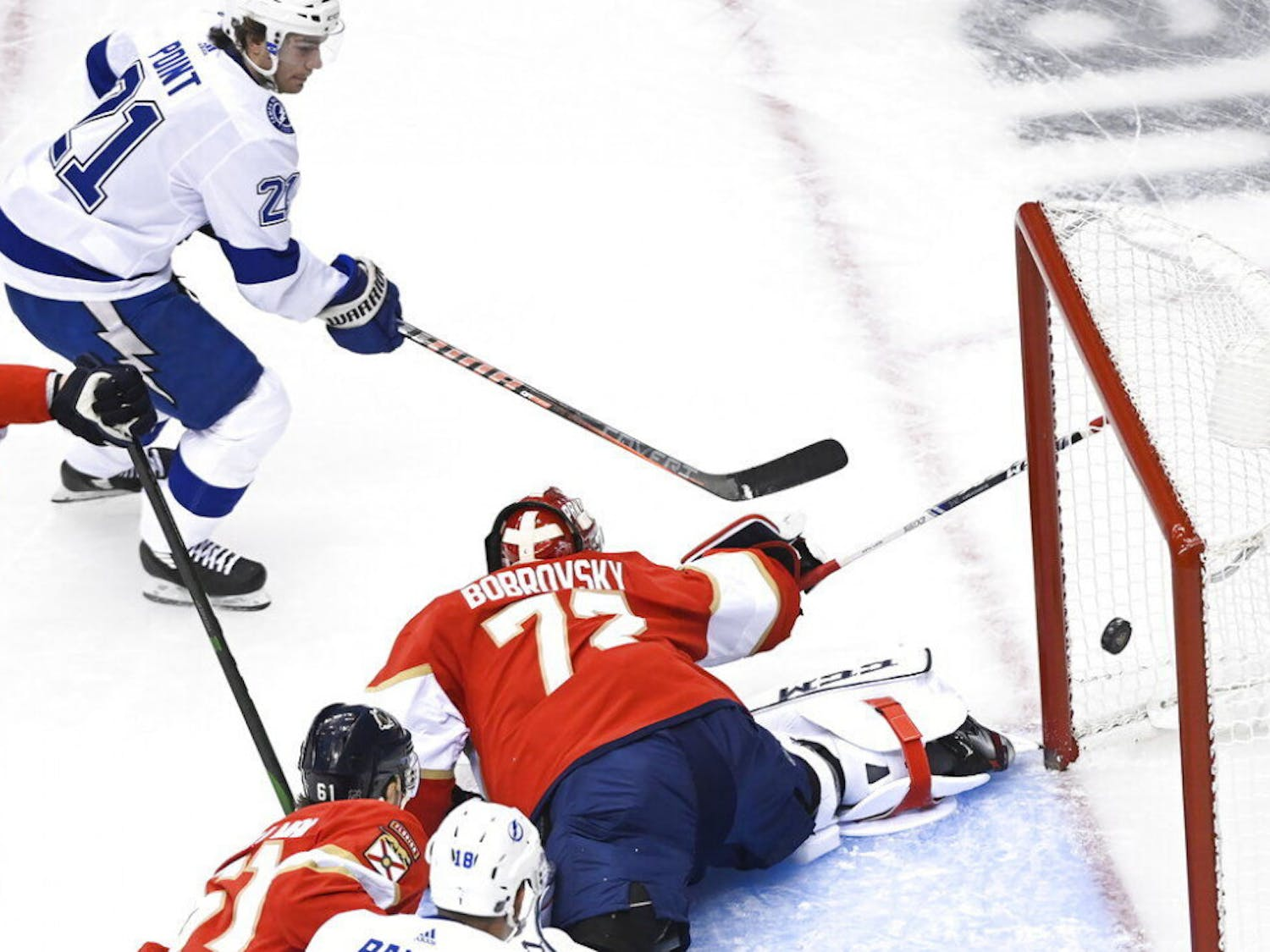 Tampa Bay Lightning center Brayden Point (21) scores past Florida Panthers goaltender Sergei Bobrovsky (72) during the first period of an exhibition NHL hockey game in Toronto, Wednesday, July 29, 2020. (Nathan Denette/The Canadian Press via AP)