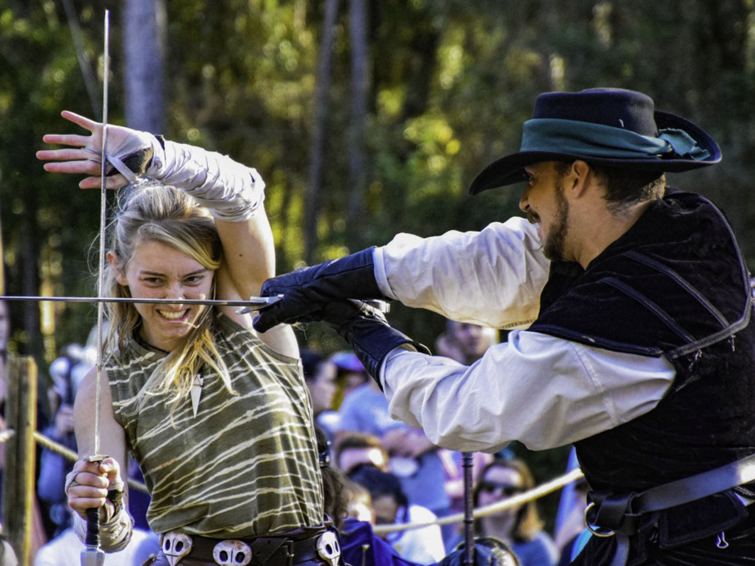 Thieves Guilde actors Sierra Barnier, 18, and Kevin Otero, 24, perform a choreographed sword fight during a chess game.