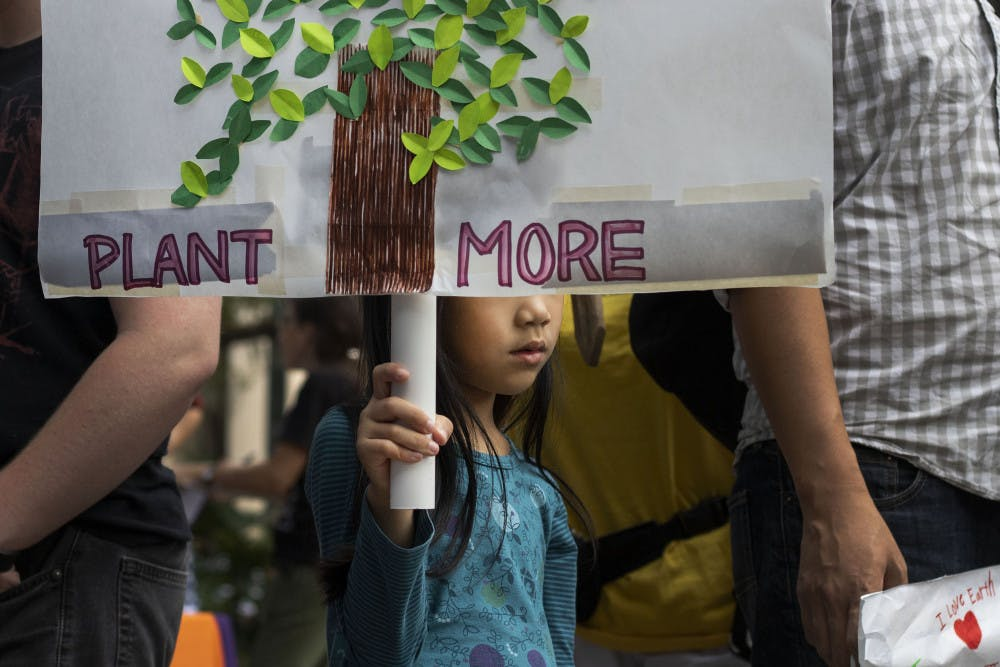 """<p dir=""""ltr""""><span>Mika Lee, 6, holds participates in the climate protest Sept. 20 at City Hall.</span></p><p><span></span></p>"""