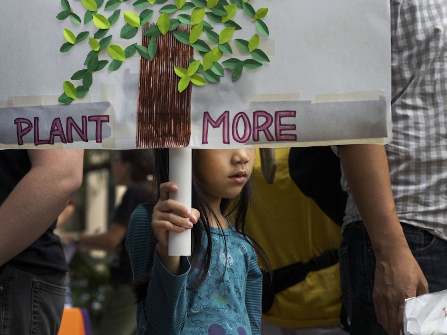 Mika Lee, 6, holds participates in the climate protest Sept. 20 at City Hall.
