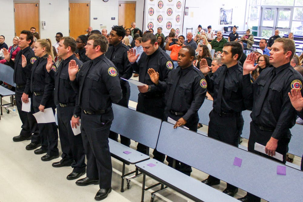 """<p dir=""""ltr""""><span>The new recruits of the</span> <span>Alachua County Fire Rescue</span> <span>swear their oath of service during the pinning ceremony on Thursday afternoon. The ceremony also celebrated the first African-American female firefighter in the county, Alex Rolle-Polk.</span></p><p><span></span></p>"""