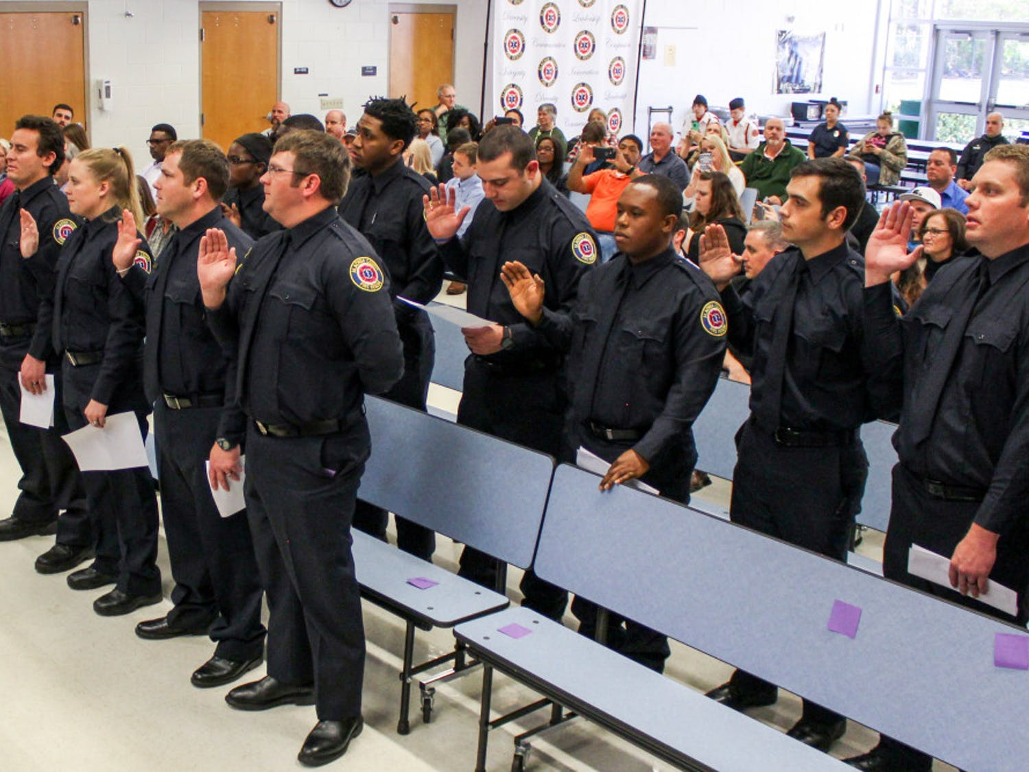 The new recruits of the Alachua County Fire Rescue swear their oath of service during the pinning ceremony on Thursday afternoon. The ceremony also celebrated the first African-American female firefighter in the county, Alex Rolle-Polk.