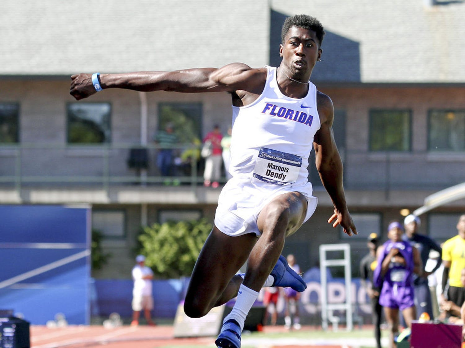 Florida's Marquis Dendy leaps on his way to winning the triple jump during the NCAA track and field championships in Eugene, Ore., Friday, June 12, 2015.