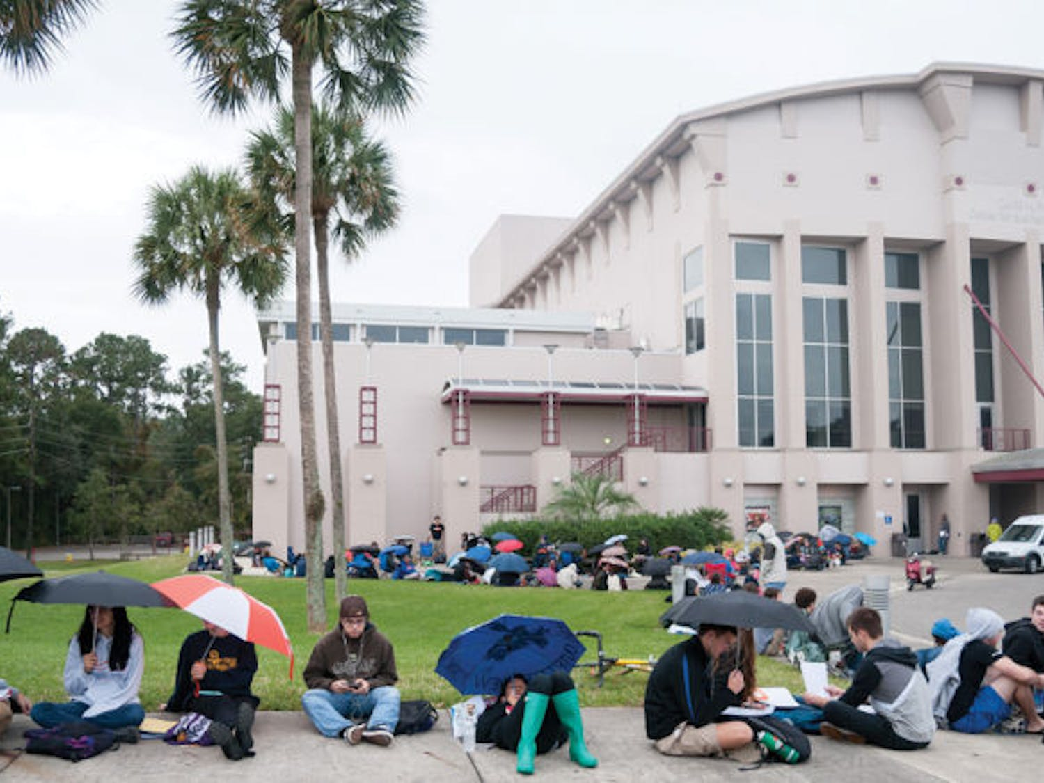 People brave the rain Wednesday morning and wait in line around the Phillips Center for the Performing Arts to get tickets for Bill Nye's event tonight, hosted by the Accent Speaker's Bureau.