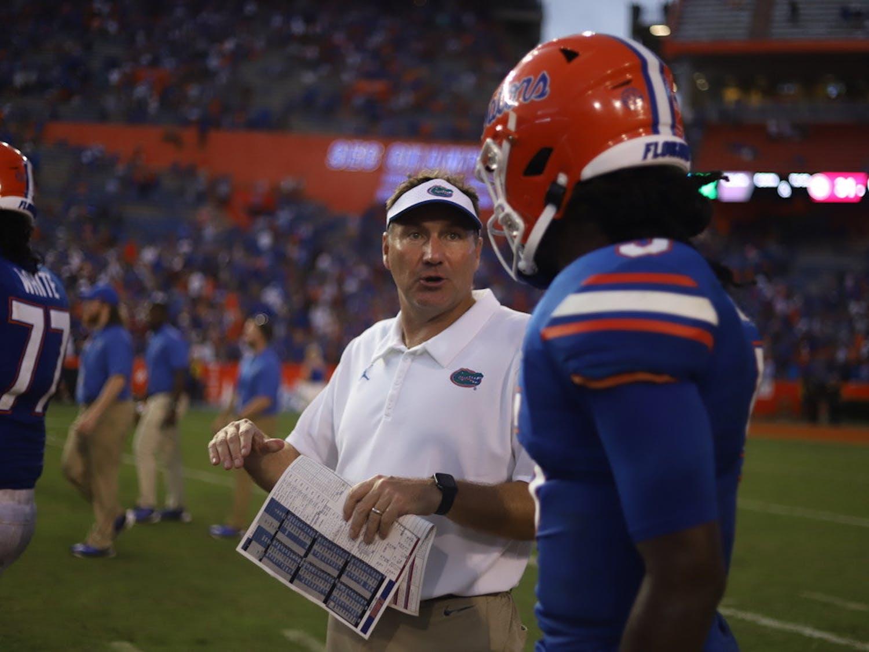 Florida football head coach Dan Mullen and quarterback Emory Jones during a game against No. 1 Alabama on Sept. 18.