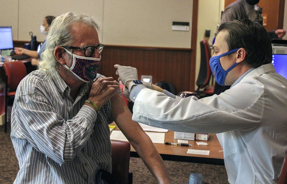 <p>Mike Foley, UF journalism professor, receives his first dose of the Pfizer-BioNTech COVID-19 vaccine on Jan. 5, 2021.</p>