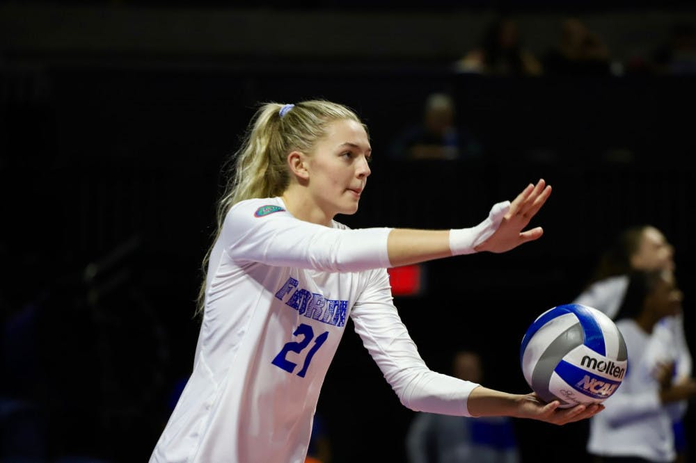 <p>Setter Marlie Monserez, pictured during 2019, prepares to serve. She recorded 38 assists Saturday in Florida&#x27;s 3-0 victory over Coastal Carolina. </p>