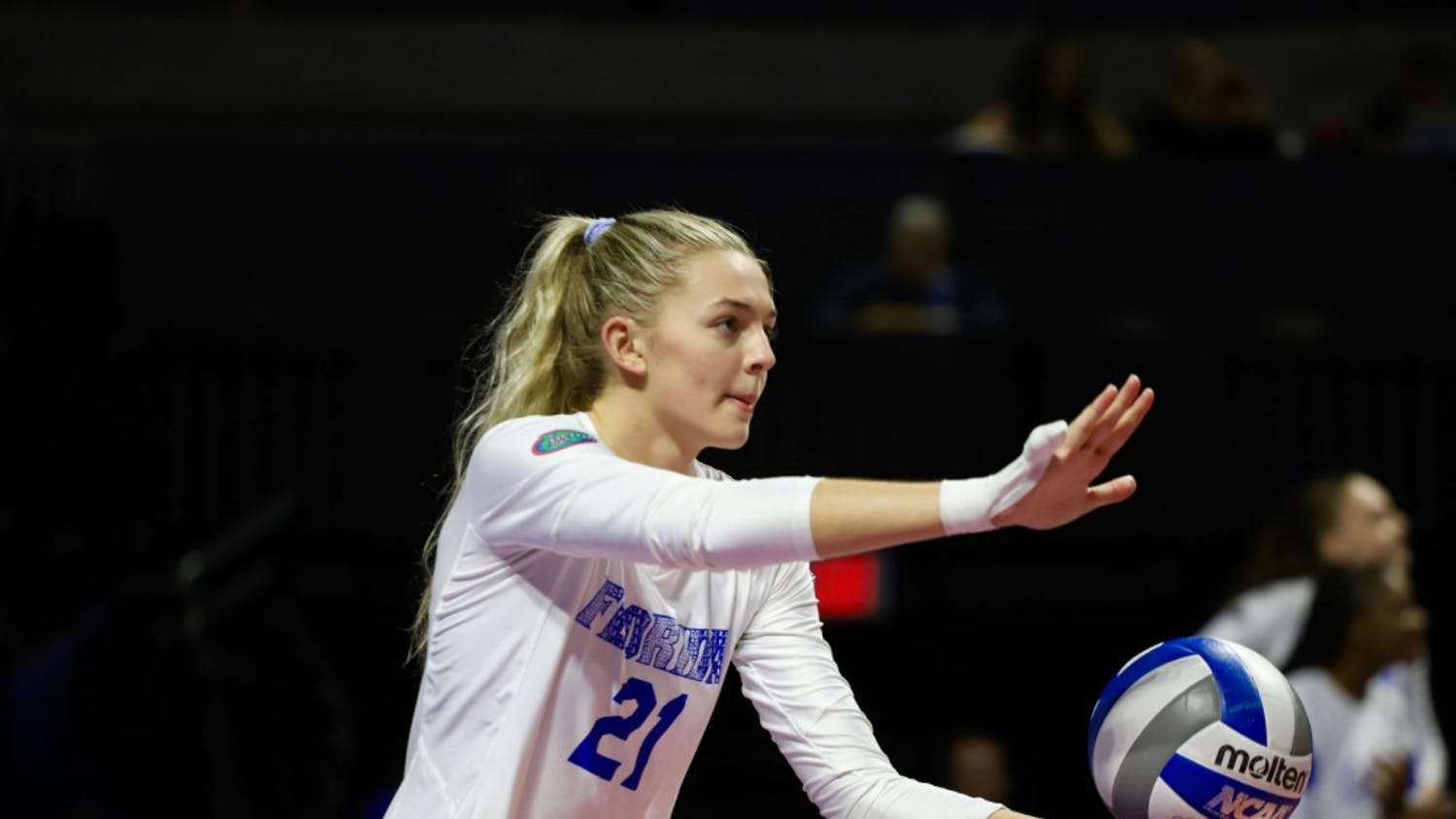 Setter Marlie Monserez, pictured during 2019, prepares to serve. She recorded 38 assists Saturday in Florida's 3-0 victory over Coastal Carolina.