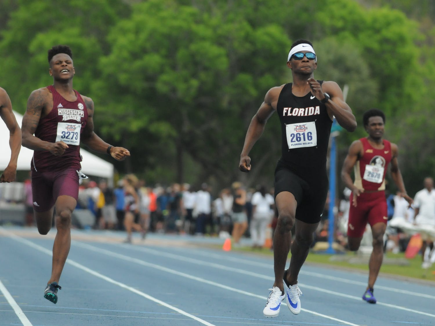 Kunle Fasasi races in the 400-meter dash during the Florida Relays on April 1, 2016, at the Percy Beard Track.