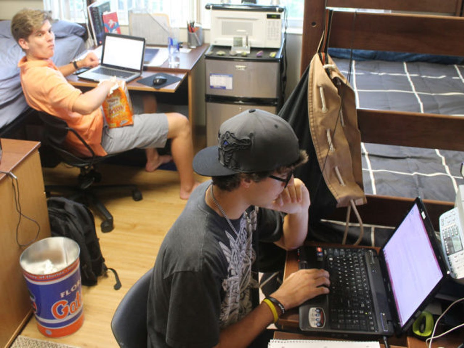 Animal science sophomore Justin Hanson, 19, right, and engineering freshman William Walker, 18, left, pass time in their dorm room Monday afternoon in Simpson Hall.