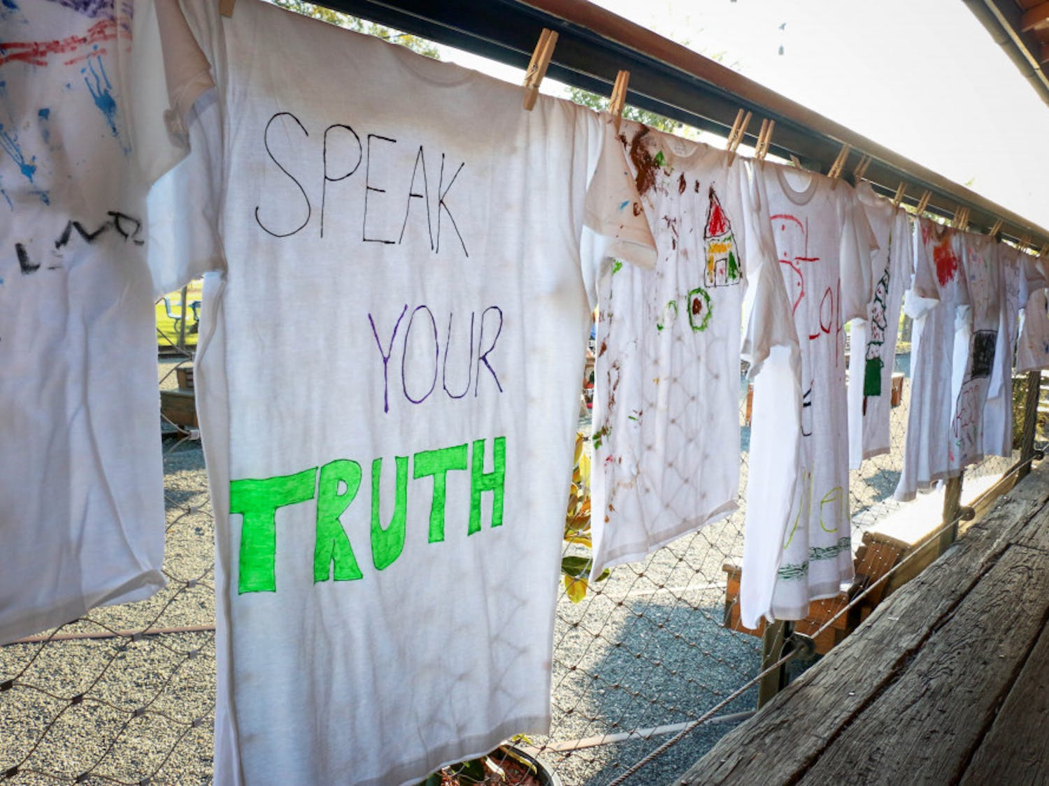 Forty-nine shirts lined the walkway at Depot Park on Oct. 4, 2018, during the Domestic Violence Community Vigil and Clothesline Project Exhibit. The Clothesline Project began in 1990 and was created to honor survivors of domestic violence and educate others about the reality of abuse. The shirts were decorated by women and children who survived domestic violence.