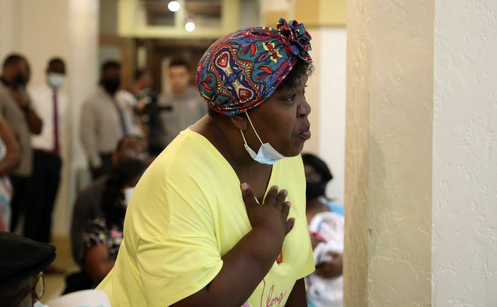 <p>Tracy Barewell-Anderson,  a Gainesville resident, holds her hand on her chest as she talks about her concerns over gun violence during the Community Call-to-Action meeting at the Thomas Center on Thursday, July 1, 2021.</p>
