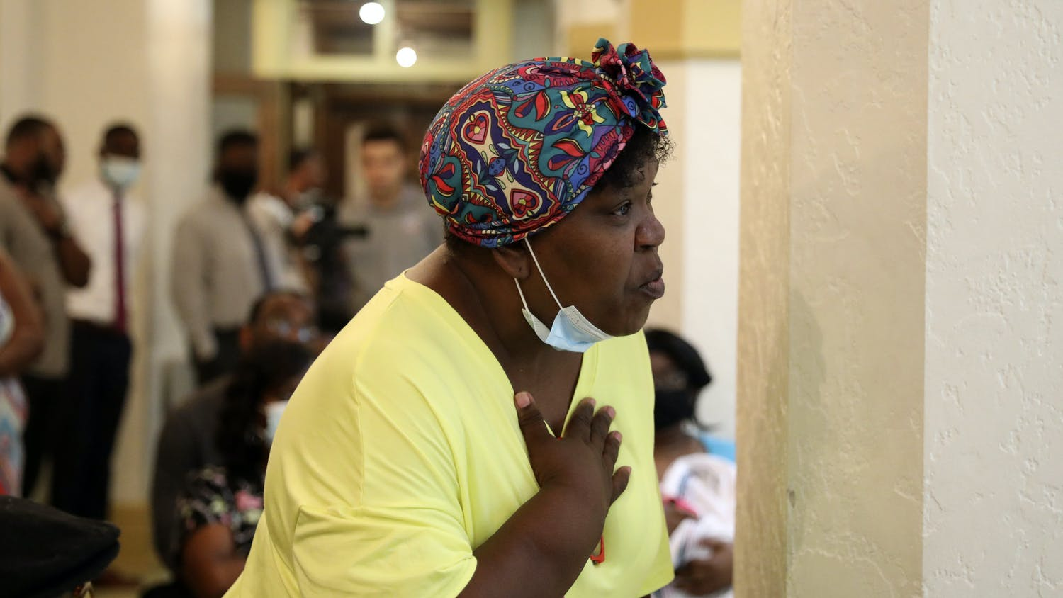 Tracy Barewell-Anderson,  a Gainesville resident, holds her hand on her chest as she talks about her concerns over gun violence during the Community Call-to-Action meeting at the Thomas Center on Thursday, July 1, 2021.