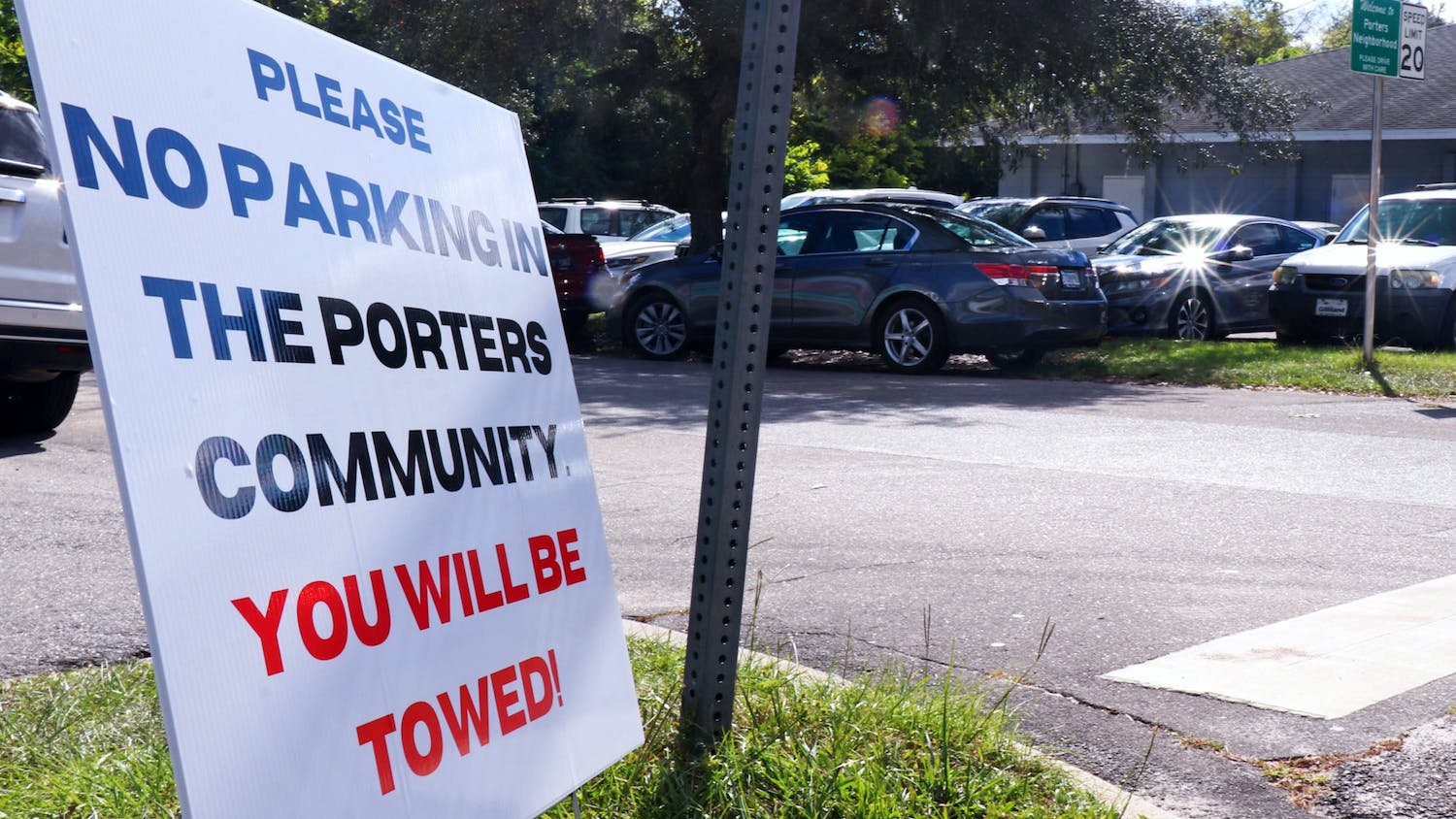 A sign is seen on the corner of Southwest Fourth Avenue and Southwest Third Street discouraging Florida Vintage Market shoppers from parking in the Porters Quarters neighborhood on Oct. 19, 2021.