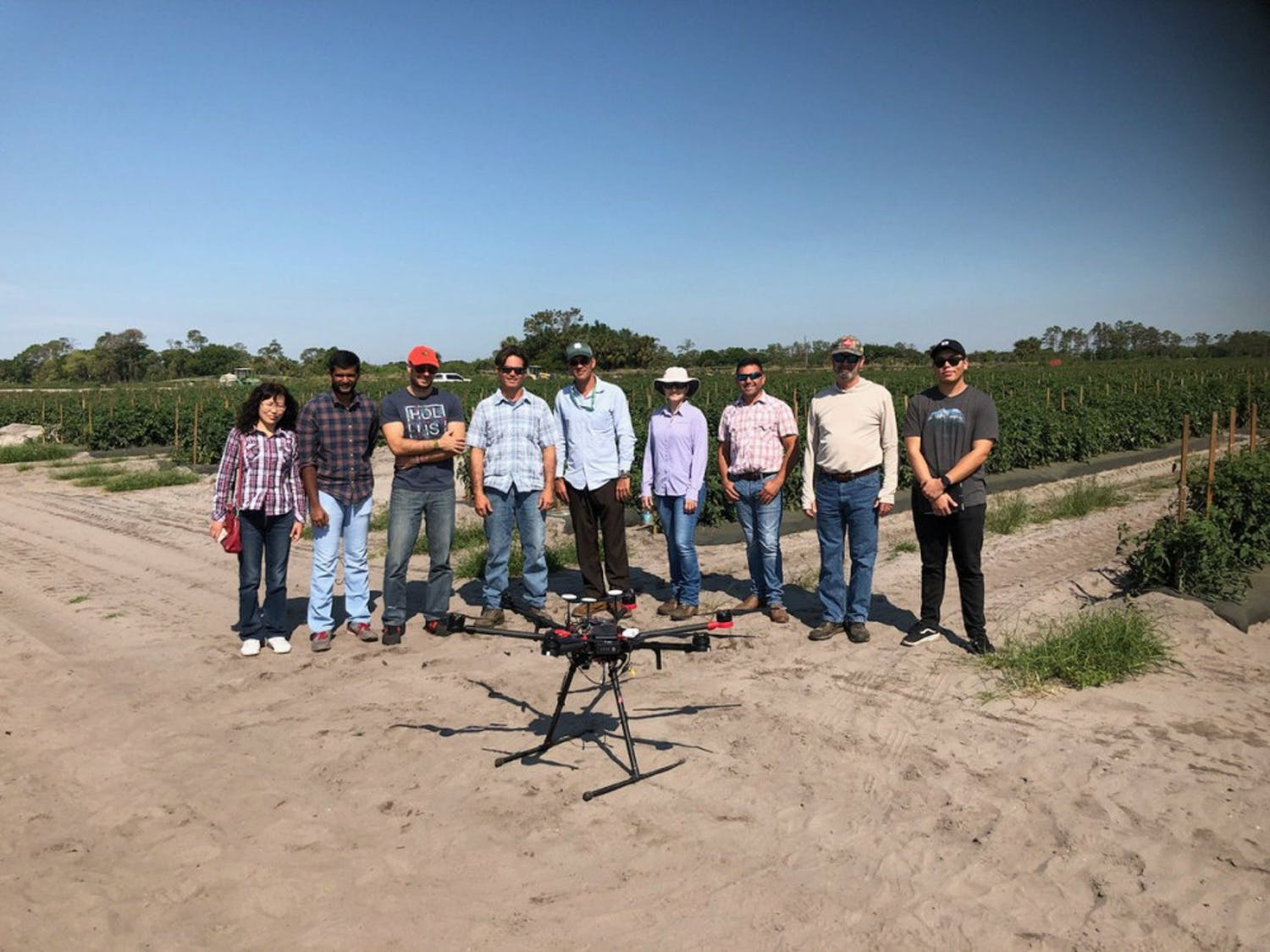 Dr. Ampatzidis (third from left) in a drone field at the UF/IFAS Southwest Florida Research and Education Center in Immokalee.