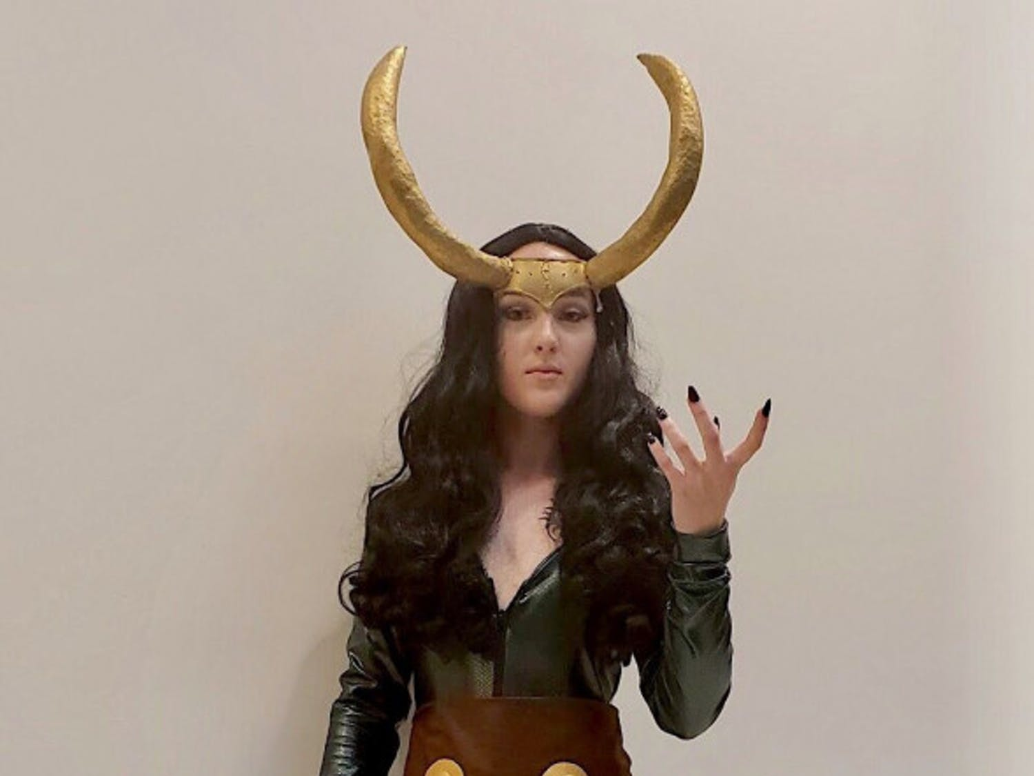 "Lady Loki Kati Ankrom, 21, resident of Leesburg, Florida, attended SwampCon as a genderbent Thor character, Lady Loki. Gender bending is when someone cosplays a character as its opposite gender. Ankrom has been improving the costume for the past four years. She first cosplayed Lady Loki when she was 18 and felt very proud when she finished the costume in nine months. Most of the cosplay is made out of a latex bodysuit and is not breathable, according to Ankrom. ""These horns I've had for like three years,"" she said. ""I refuse to get rid of them."" She advises first-time cosplayers to not make the costume harder than it needs to be. ""You will get better eventually,"" she said. ""Just start at the beginning and work your way up."""