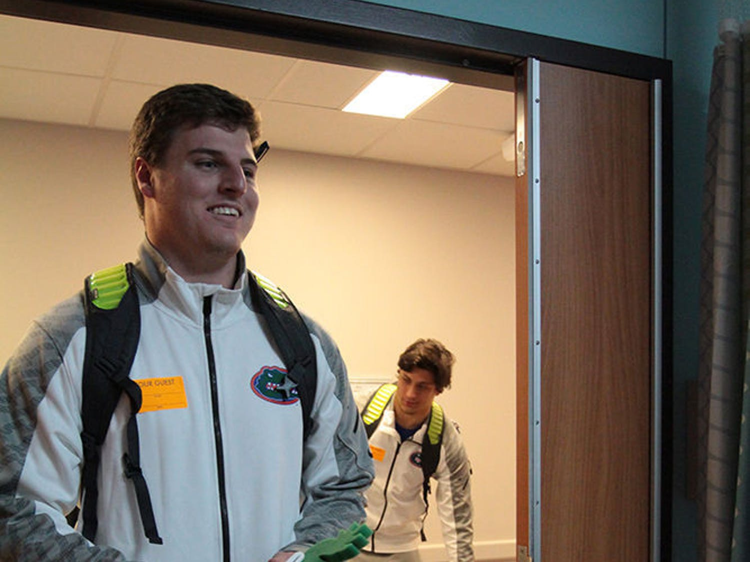 UF tight end Jake McGee and defensive lineman Jordan Sherit visit a patient at the Children's Hospital of Alabama at UAB in Birmingham on Thursday.