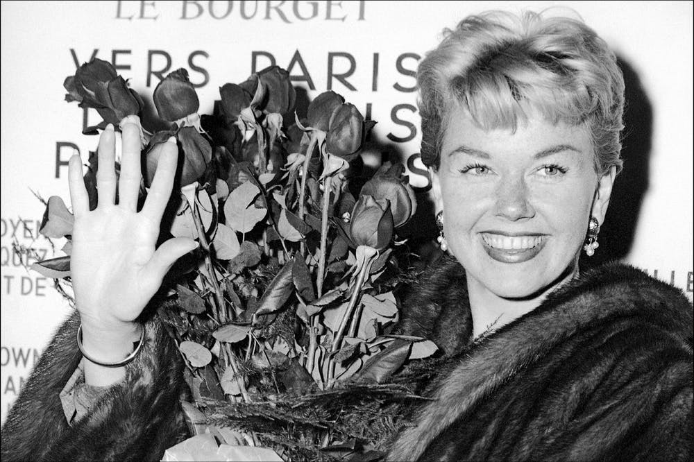 <p><span>In this April 15, 1955, file photo, American actress and singer Doris Day holds a bouquet of roses at Le Bourget Airport in Paris after flying in from London. The Doris Day Animal Foundation confirmed Day died early Monday, May 13, 2019, at her home in Carmel Valley, Calif. She was 97.</span></p>