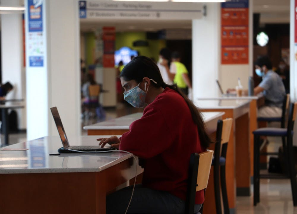 A photo of a student studying in Reitz Union