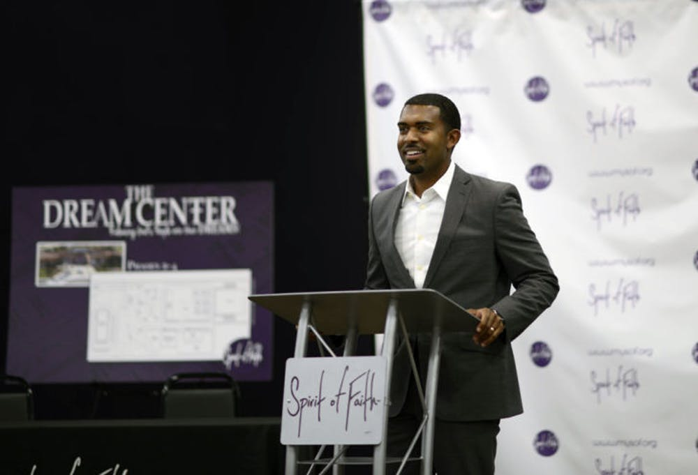 <p>Spirit of Faith Pastor Kenneth Claytor speaks at the Spirit of Faith Dream Center on Thursday. The church raised $300,000 to buy the site formerly owned by the Rev. Terry Jones.</p>