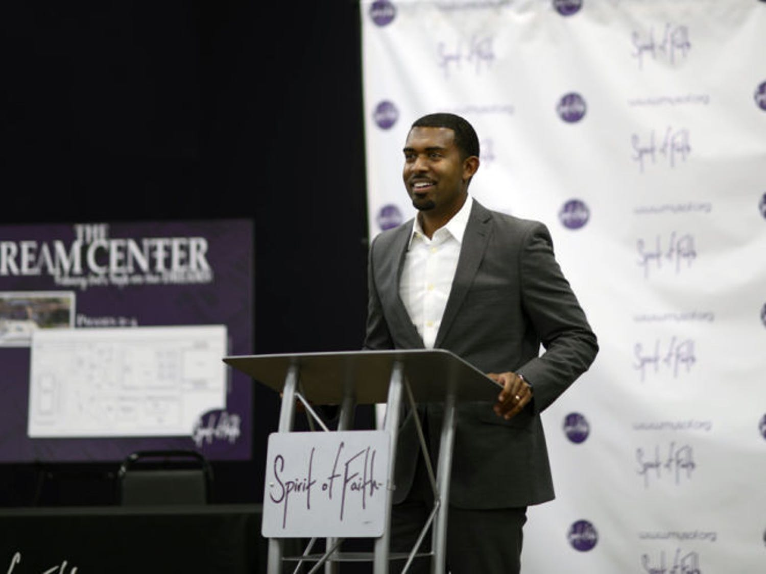 Spirit of Faith Pastor Kenneth Claytor speaks at the Spirit of Faith Dream Center on Thursday. The church raised $300,000 to buy the site formerly owned by the Rev. Terry Jones.