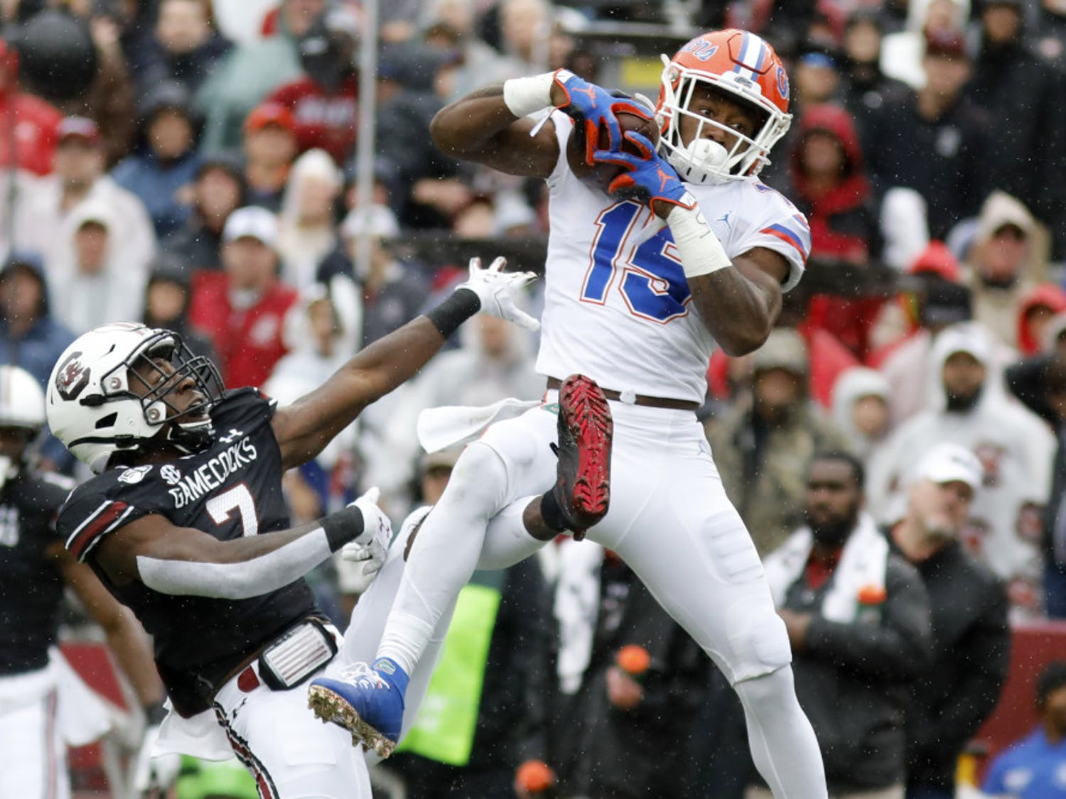Florida's Jacob Copeland (15) catches a pass for a touchdown as South Carolina's Jammie Robinson (7) defends in the first half of an NCAA college football game Saturday, Oct. 19, 2019, in Columbia, SC.